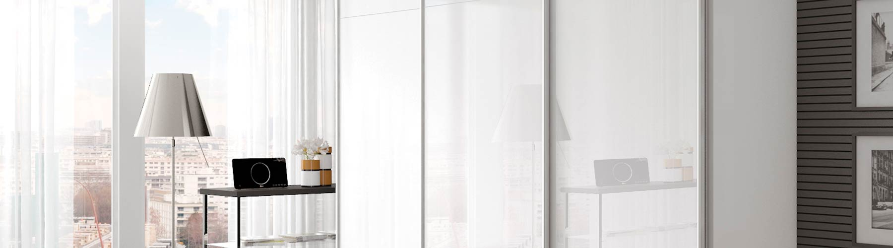 f8c18d470 Gloss white sliding wardrobe doors with matt grey handles.