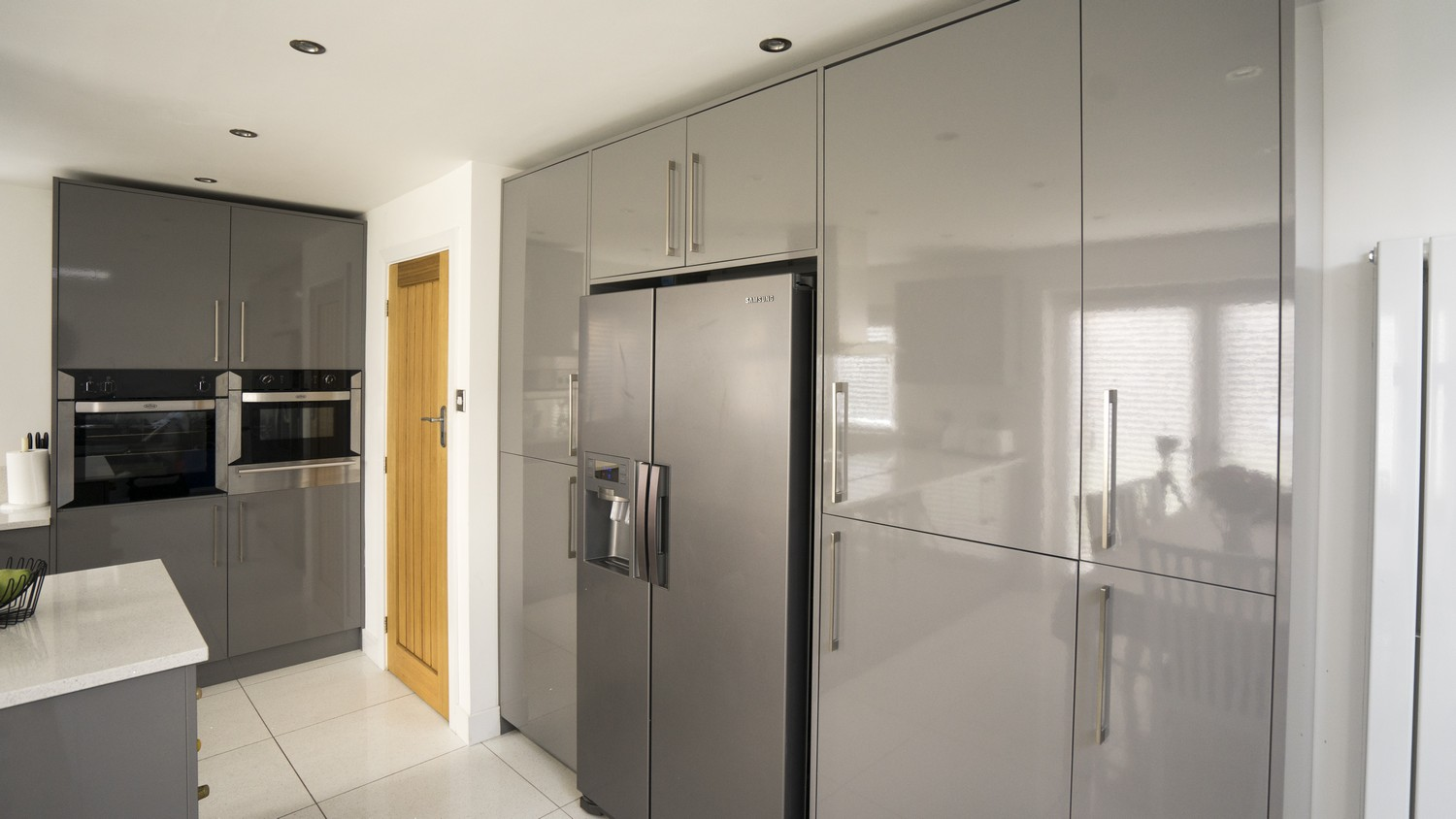 Grey gloss kitchen cleveland kitchens liverpool for Long kitchen wall units