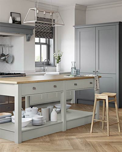 Traditional Kitchens Liverpool, featuring simple timber shaker doors painted with a matt finish. Timber block worktops and authentic hardware.