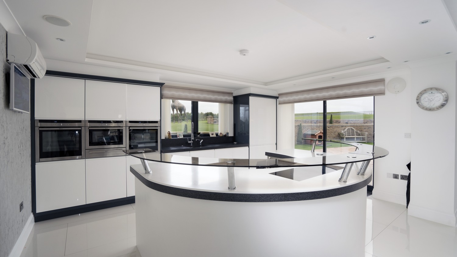 Main shot of this stunning designer kitchen in Liverpool, featuing various integrated NEFF appliances, built-in sink and flush ceramic hob.