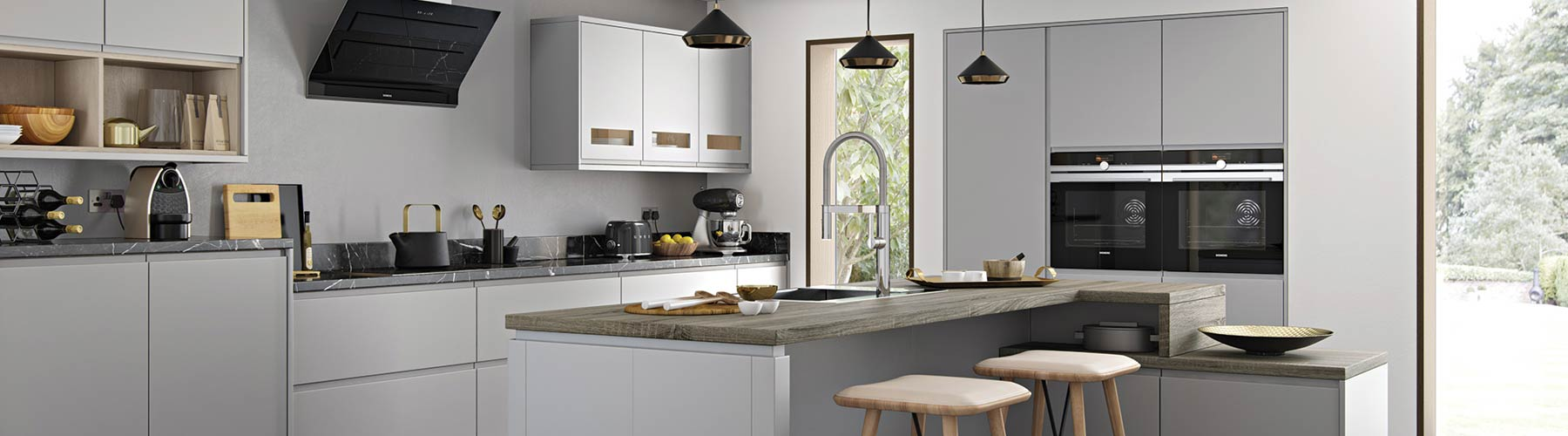 A grey handle-less kitchen with a range of different cupboard styles, island and unique patterned worktops.