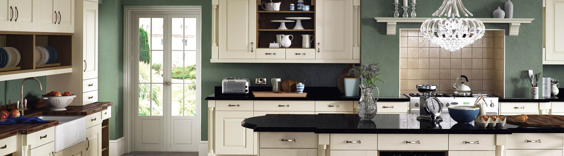 A classic ivory panel kitchen with unique detailing and granite worktops.