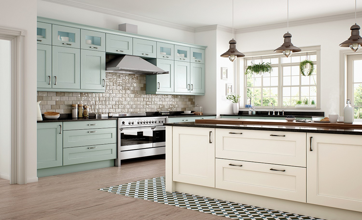 A classic Ivory and powder blue shaker kitchen design with black granite worktops and large extraction hood.