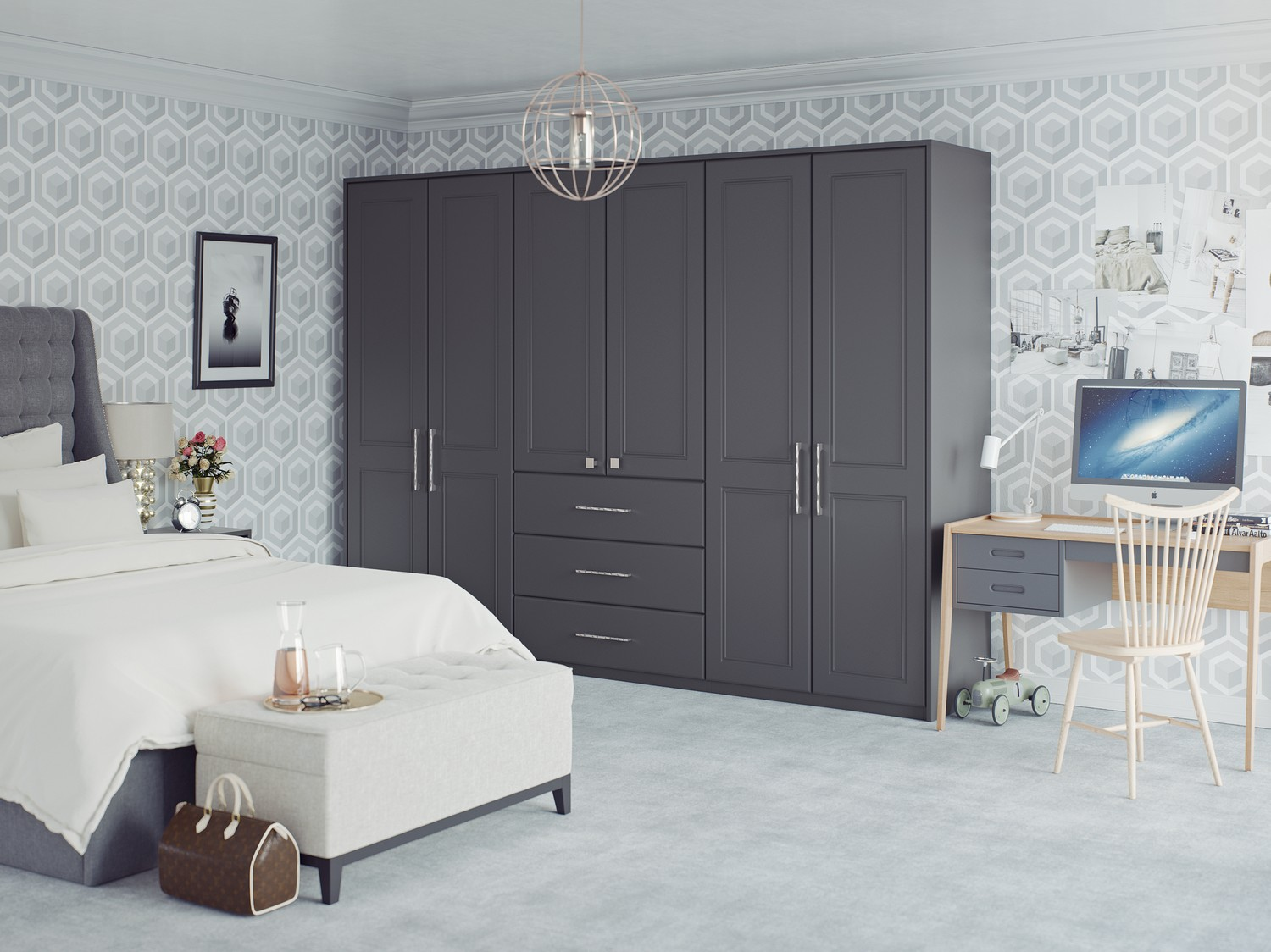 Matt graphite fitted wardrobes for our client in Heswall, Wirral. The fitted wardrobe features three individual wardrobes and a draw set, combined with dual handle styles this bedroom furniture is right on trend and gives a contemporary edge to any bedroom.