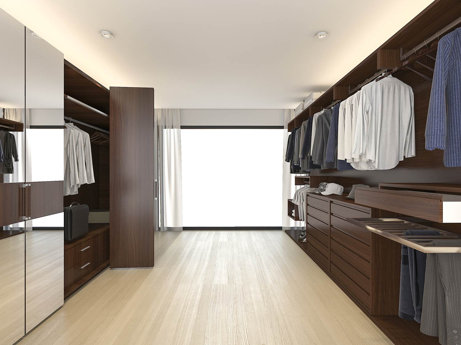 Large designer walnut walk in wardrobe with various storage solutions as well as mirrored doors hiding some areas of the wardrobe. Pull out trouser storage and handle-less draws make this the perfect space.