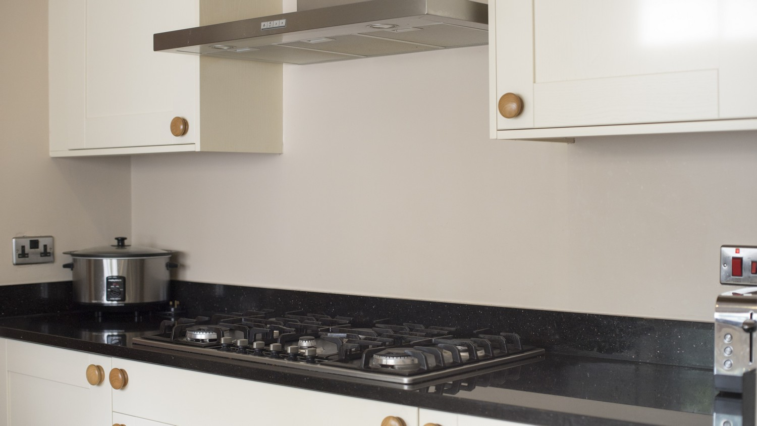 Close up of the large cooking hob and extractor fan.