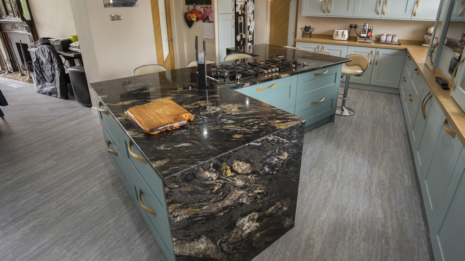 Another view of the stunning marble worktop using on the island of this kitchen.