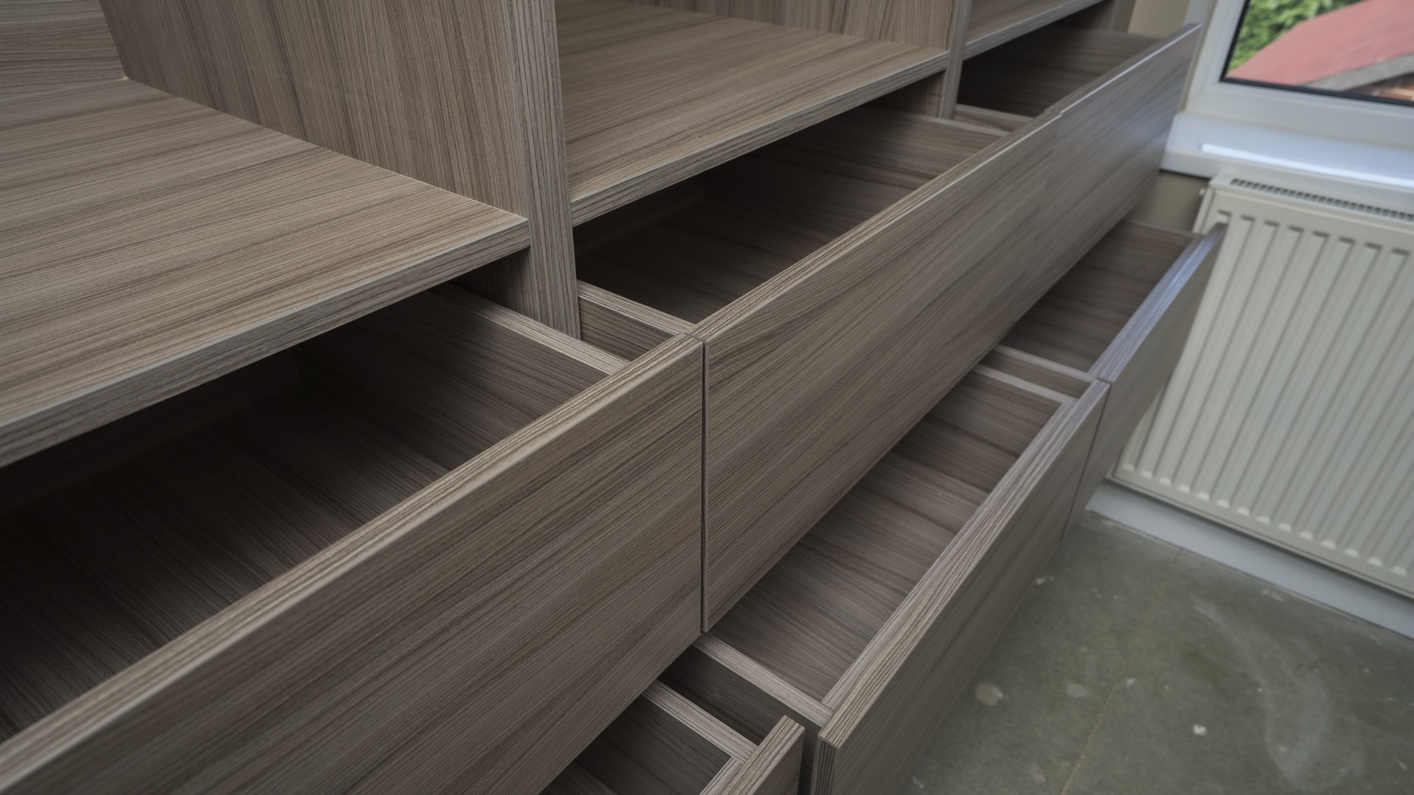 Close up of the 6 drawers on the left side of the walk in wardrobe, Wirral.