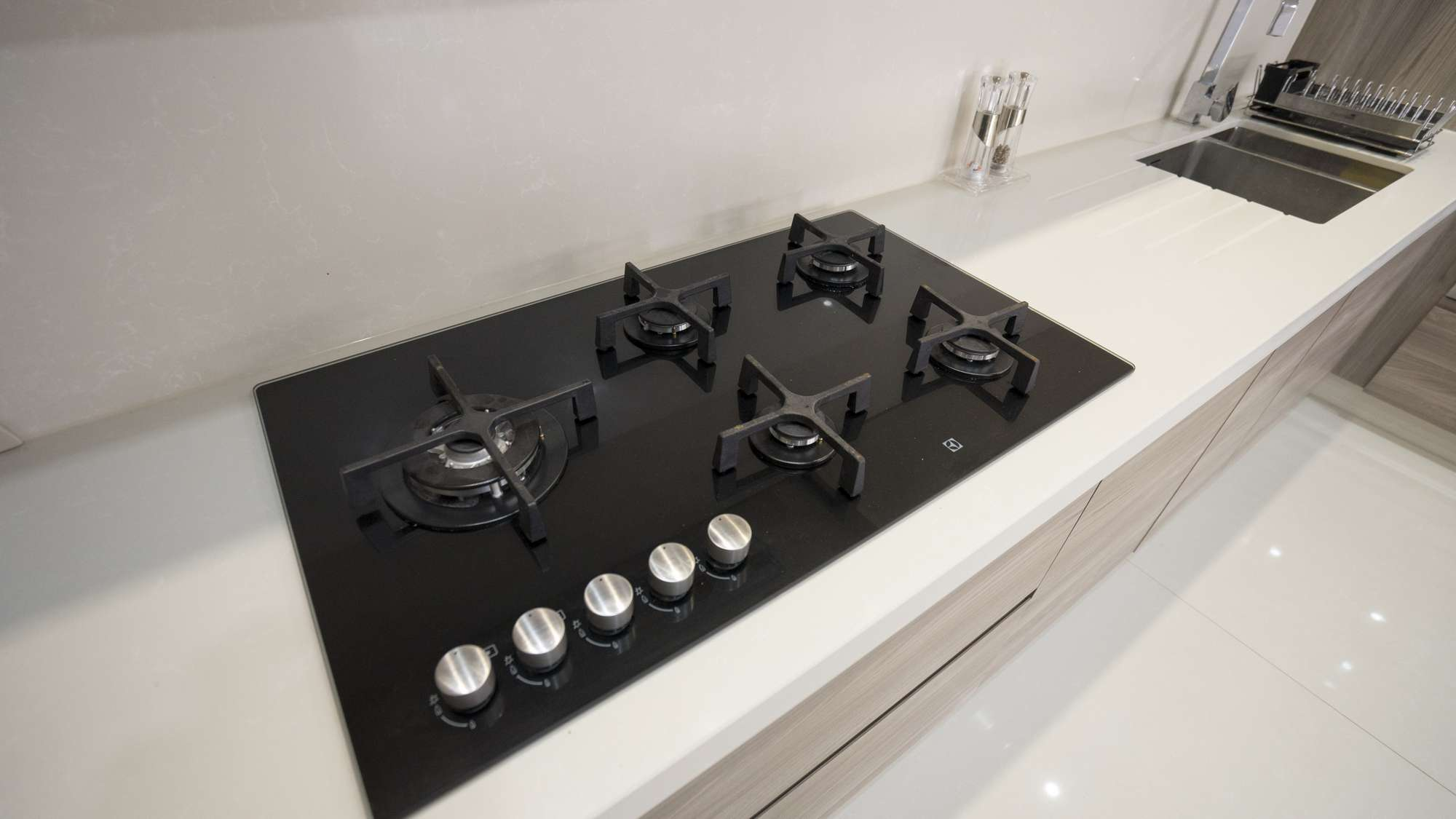 Close up of the high end cooking hob in black ceramic.