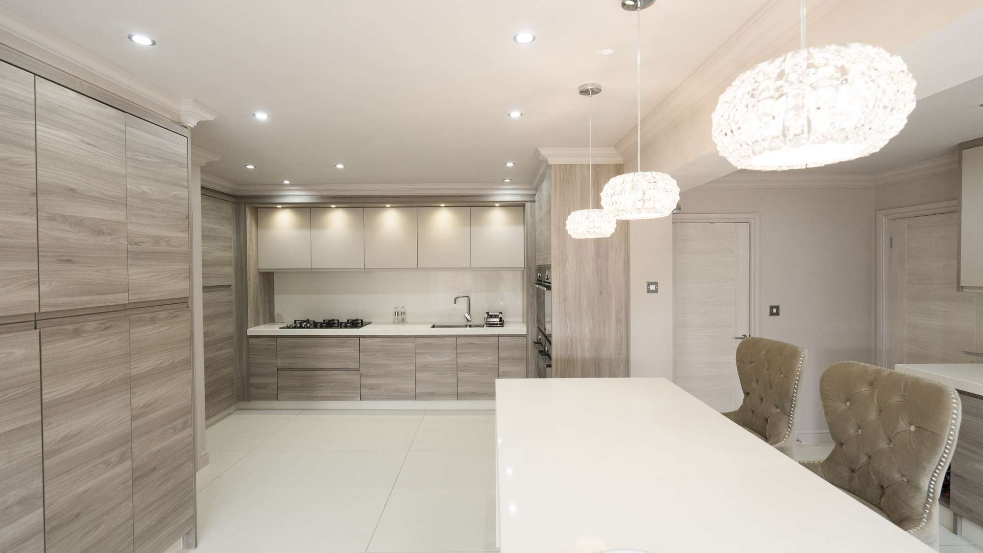 Straight on view of this designer handle-less kitchen installed in Liverpool.