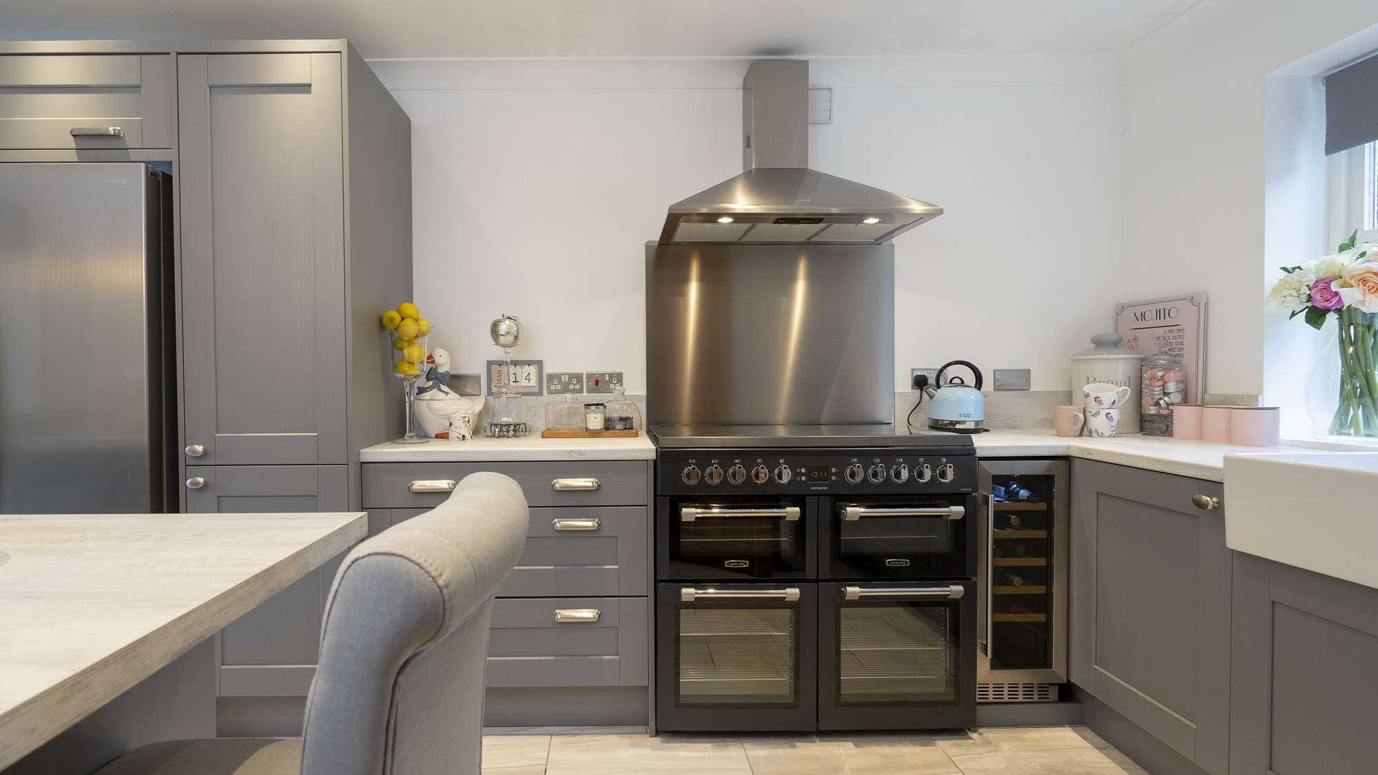 Close up of the large range cooker and stainless extractor fan.
