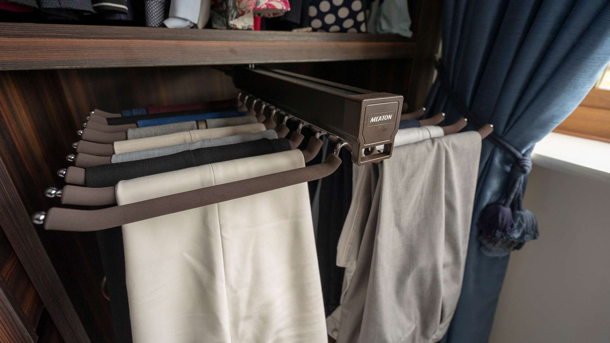 Close up shot of the pull out trouser racks.