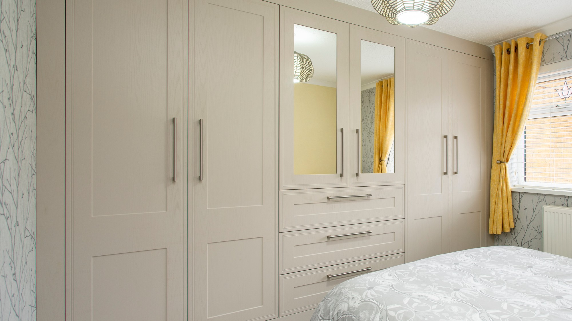 Closeup of our tullymore fitted bedroom furniture in cashmere, supplied and fitted in Crosby Liverpool.