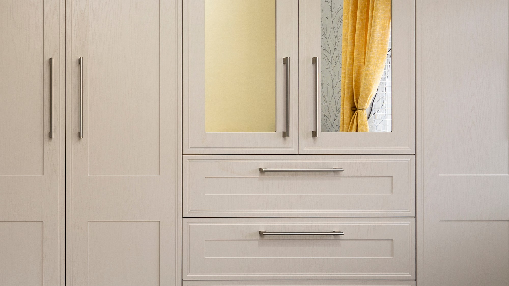 Straight on view showing the wood-grain effect and stainless steel handles of our tulleymore door collection.